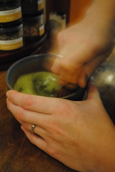 Whisk together 2 TBS matcha powder & 1 cup of hot water